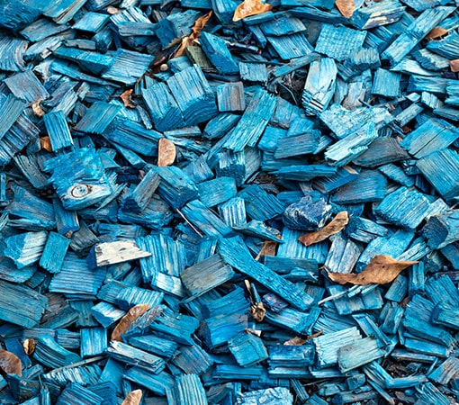 Blue wood waste chip mulch